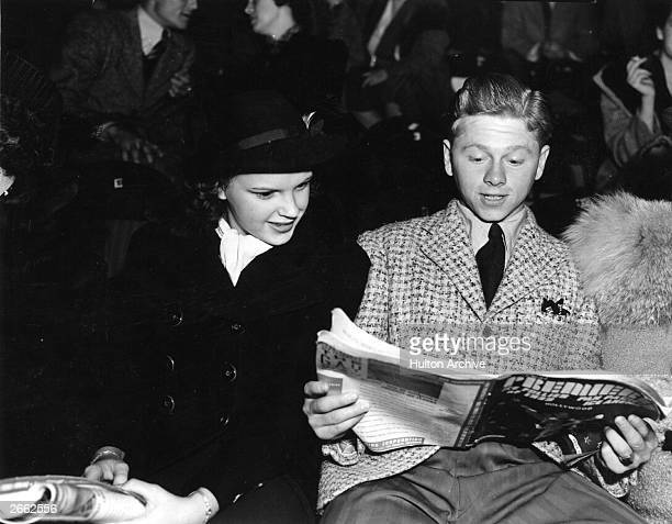 Mickey Rooney the American film actor and Judy Garland the American entertainer examine the programme at the Ice Follies Original Publication People...