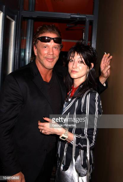 Mickey Rourke and Floria Sigismondi during 2002 Toronto Film Festival Roots and ICM Party at Brasserie Aix Bar in Toronto Ontario Canada