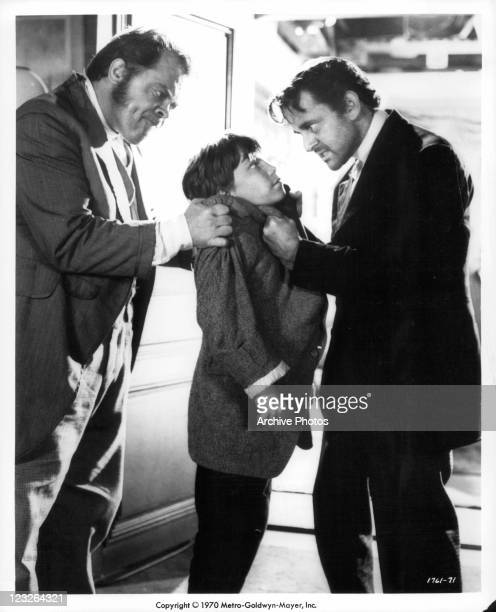 Mickey Shaughnessy and Tony Randall warn Eddie Hodges to play along with their scheming in a scene from the film 'The Adventures Of Huckleberry Finn'...