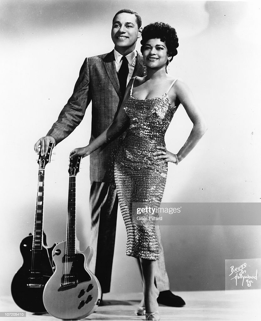Mickey & Sylvia (Mickey 'Guitar' Baker and Sylvia Vanderpool Robinson) pose for a studio group portrait in 1956 in the United States. The hold a Gibson Les Paul and Gibson Les Paul Special guitar.