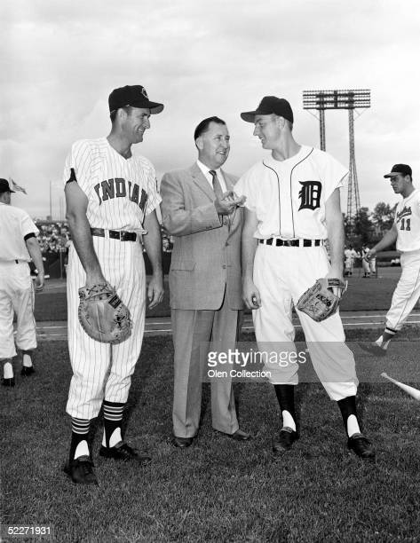 Mickey Vernon of the Cleveland Indians and Al Kaline of the Detroit Tigers pose for a portrait with a representative of Wilson Sporting Goods prior...