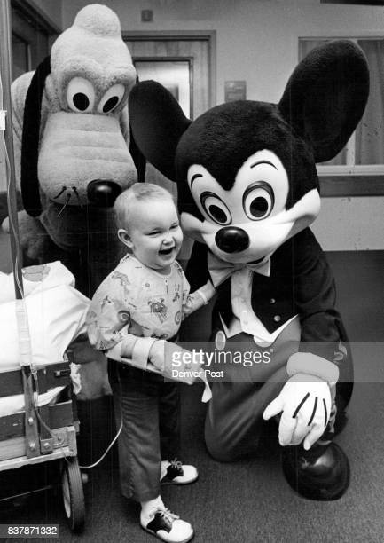"Mickey Visits Hospital ""I got him Mom I gave him a kiss' Joseph Denton below seems especially proud of himself Thursday after he planted a kiss on..."