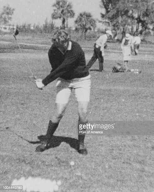 Mickey Wright hits her tee shot