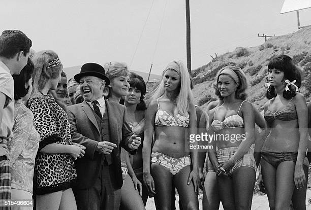 Mickey's Beauties Malibu Beach Calif Mickey Rooney gags it up for some of the shapely bikini clad beauties who appear in American International's How...