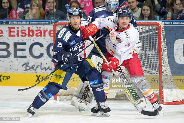 Micki DuPont of the Eisbaeren Berlin and Manuel Strodel of the Duesseldorfer EG during the DEL game between the Eisbaeren Berlin and Duesseldorfer EG...