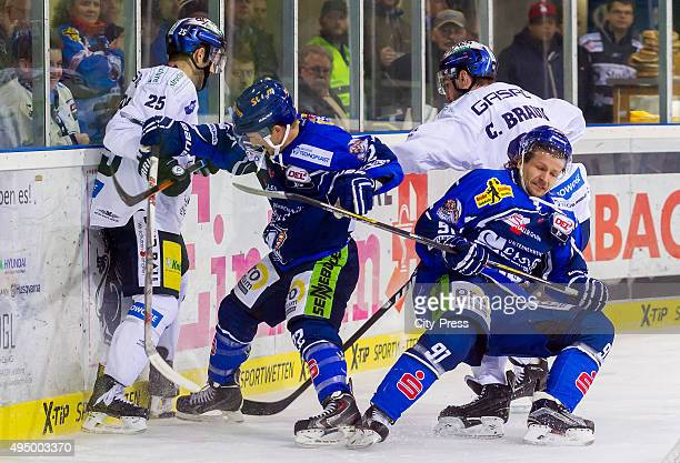 Micki DuPont of the Eisbaeren Berlin Mike Connolly Rene Roethke of Straubing Tigers and Constantin Braun of the Eisbaeren Berlin during the game...
