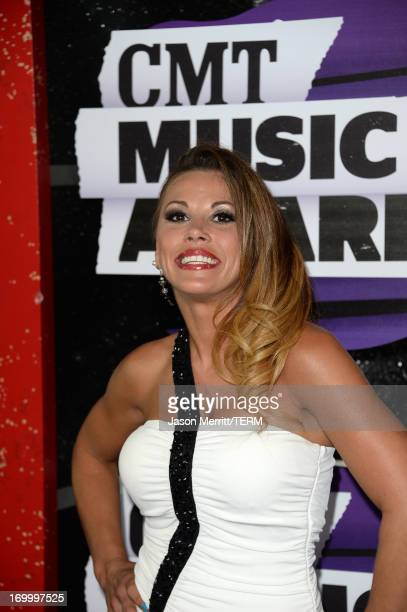 Mickie James attends the 2013 CMT Music awards at the Bridgestone Arena on June 5 2013 in Nashville Tennessee