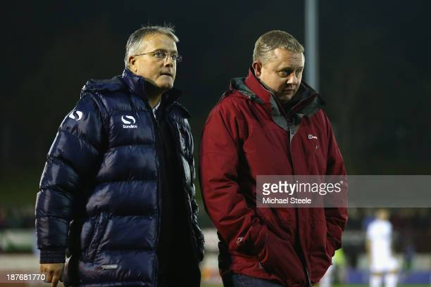 Micky Adams manager of Port Vale walks to the dugout alongside journalist Neil Moxley during the FA Cup First Round match between Shortwood United...