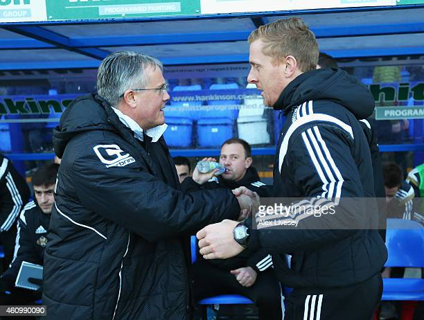 Micky Adams manager of Tranmere greets Garry Monk manager of Swansea City during the FA Cup Third Round match between Tranmere Rovers and Swansea...