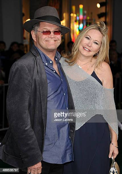 Micky Dolenz and wife Donna Quinter attend the premiere of Million Dollar Arm at the El Capitan Theatre on May 6 2014 in Hollywood California