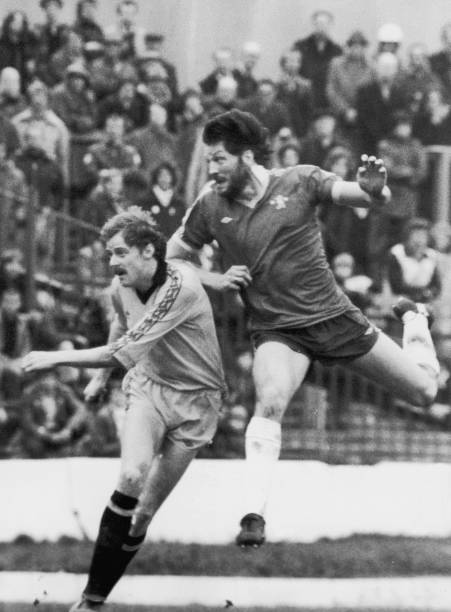 Micky Droy of Chelsea heads the ball over George Reilly of Cambridge United during a match at Stamford Bridge, London, 7th February 1981.