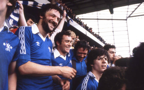 Micky Droy, Ron Harris and Michael Nutton of Chelsea celebrate with fans in the East Stand Directors Box after the Football League Division 2 match...