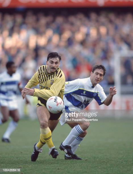 Micky Gynn of Coventry moves away from Kenny Sansom of Queens Park Rangers during a Barclays League Division One match at Loftus Road on December 26...