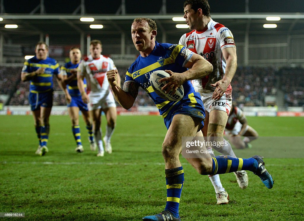 Micky Higham of Warrington Wolves celebrates his second half try during the First Utility Super League match between St Helens and Warrington Wolves at Langtree Park on March 19, 2015 in St Helens, England.