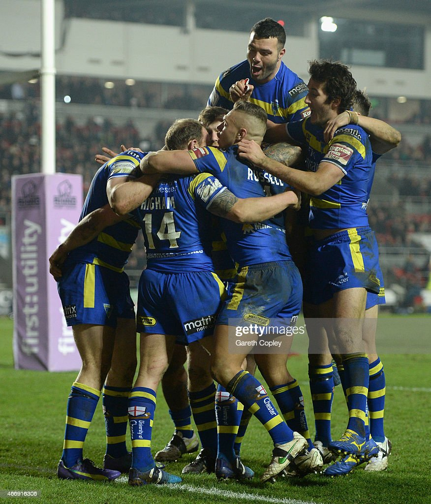 Micky Higham of Warrington Wolves is mobbed by teammates after scoring his second half try during the First Utility Super League match between St Helens and Warrington Wolves at Langtree Park on March 19, 2015 in St Helens, England.