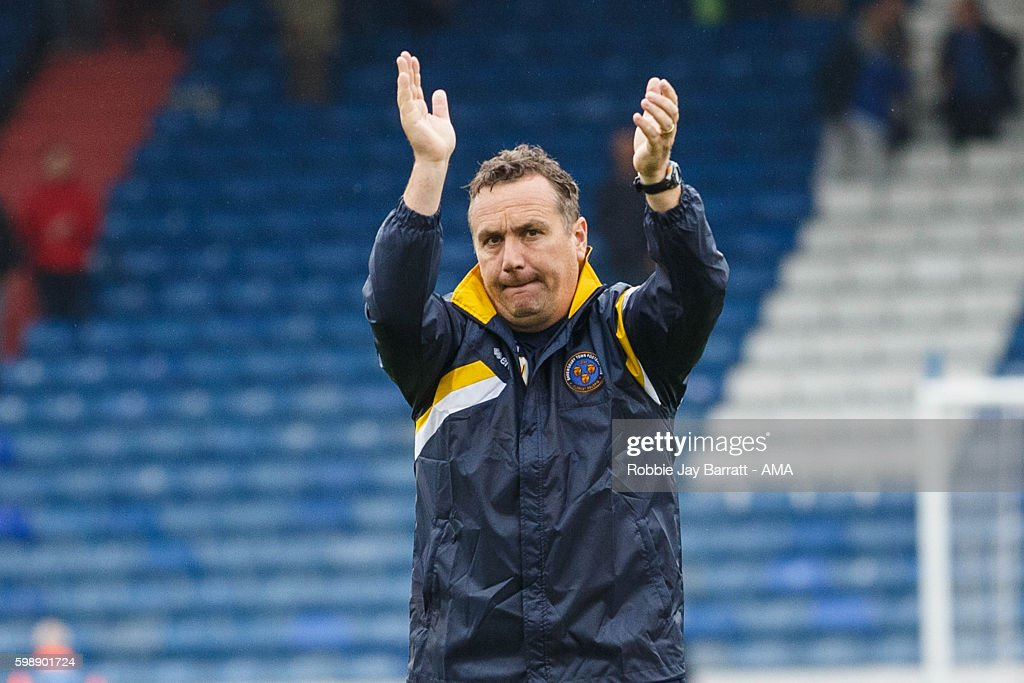 Micky Mellon manager of Shrewsbury Town applauds the Shrewsbury Town fans at full time during the Sky Bet League One match between Oldham Athletic and Shrewsbury Town at Boundary Park on September 3, 2016 in Oldham, England.