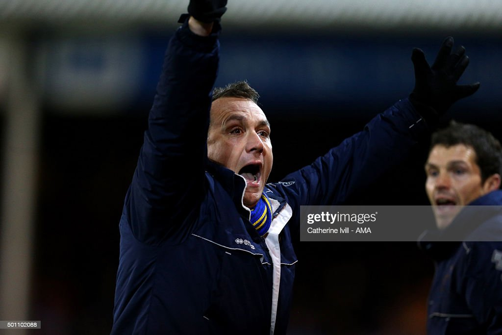 Micky Mellon manager of Shrewsbury Town celebrates after Tyrone Barnett of Shrewsbury Town scores to make it 1-1 during the Sky Bet League One match between Peterborough United and Shrewsbury Town at London Road Stadium on December 12, 2015 in Peterborough, England.