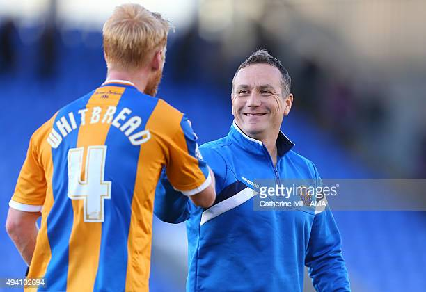 Micky Mellon manager of Shrewsbury Town with Zak Whitbread of Shrewsbury Town after the Sky Bet League One match between Shrewsbury Town and Bury at...