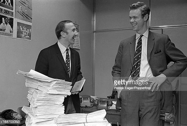 Micky Stewart and Christopher MartinJenkins assistant editor The Cricketer drawing 'luck numbers' in The Cricketer office in Great Portland Street...