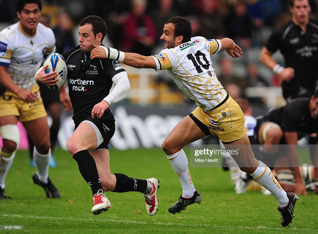 Micky Young of Newcastle (L) breaks away from Frederic Manca of Albi during the Amlin Challenge Cup match between Newcastle Falcons and Albi at Kingston Park on October 18, 2009 in Newcastle upon Tyne, England.