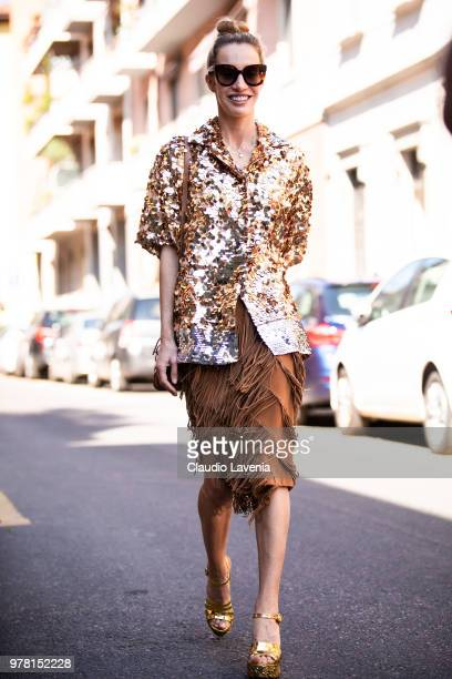Micol Sabbadini wearing a N21 sequin top and brown skirt is seen in the streets of Milan before the N21 show during Milan Men's Fashion Week...