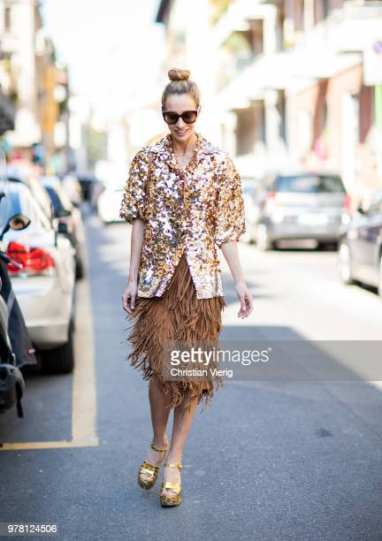 Micol Sabbadini wearing golden glitter jacket skirt with fringes plattform sandals is seen outside N21 during Milan Men's Fashion Week Spring/Summer...