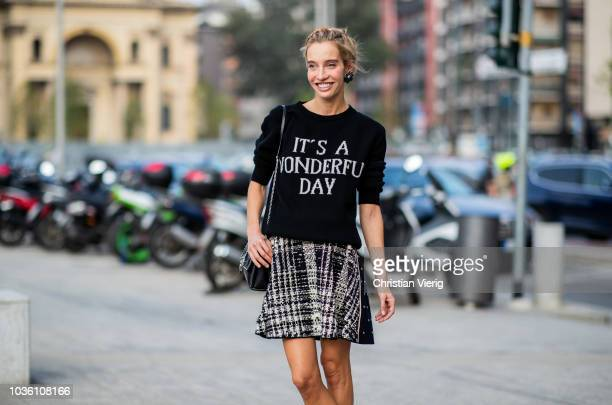 Micol Sabbadini wearing skirt, sweater with print it's a wonderful day is seen outside Alberta Ferretti during Milan Fashion Week Spring/Summer 2019...
