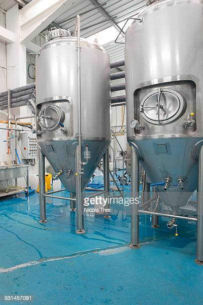 micro brewery, beer fermentation tanks - the brewery london stock photos and pictures