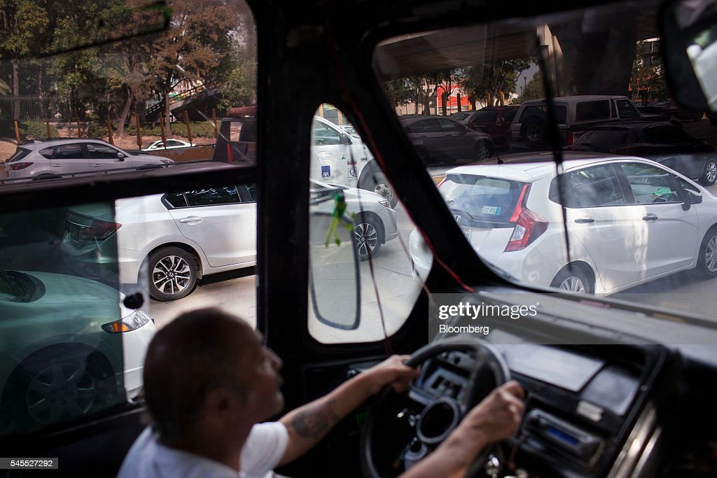 A micro bus driver moves through traffic in Mexico City, Mexico, on Friday, June 17, 2016. The air quality in Mexico City has risen above the government's acceptable limits triggering restrictions on automobile usage and stricter vehicle emissions testing. Photographer: Brett Gundlock/Bloomberg via Getty Images
