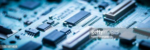 micro chip on blue circuit board - cpu stock pictures, royalty-free photos & images
