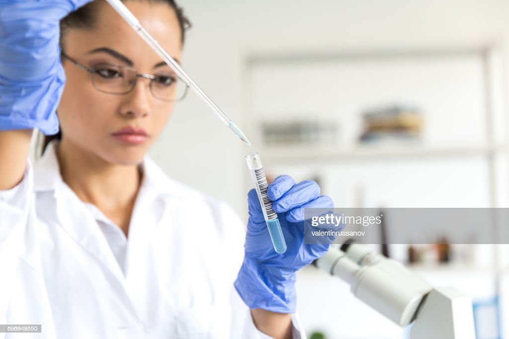 Microbiologist in laboratory : Stock Photo