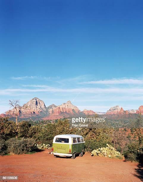 Microbus in desert landscape