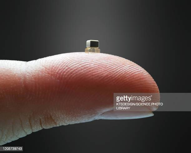 microchip on finger - computer chip stock pictures, royalty-free photos & images