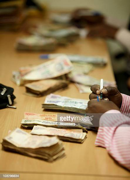 SKS Microfinance Ltd employees count money collected from borrowers at a branch office in Sadasivpet India on Friday Aug 6 2010 SKS provides loans...