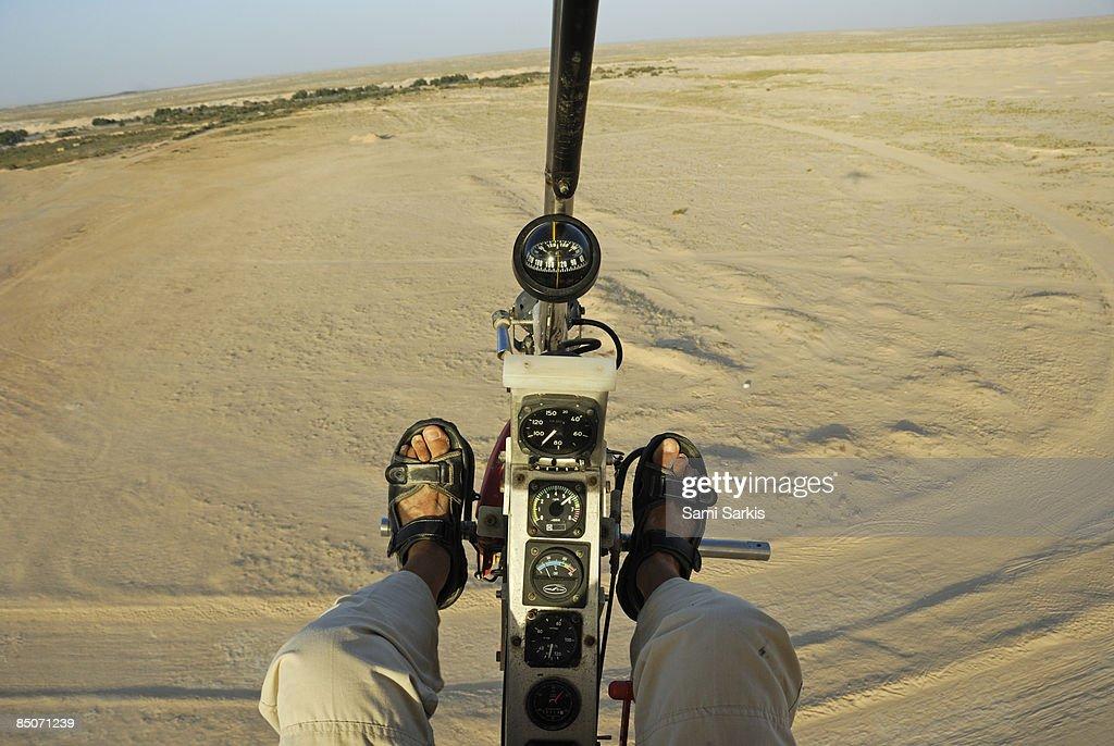 Microlite plane pilot, flying over Sahara desert : Stock Photo