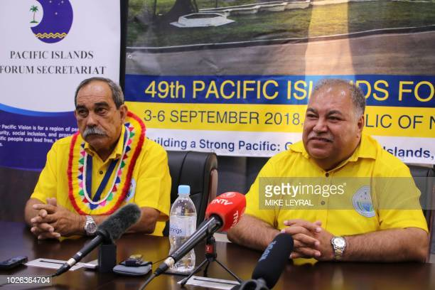 Micronesia's President Peter Christian and Nauru's President Baron Waqa attend a press conference after the Small Island States meeting in Aiwo on...