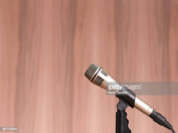 microphone against wooden background