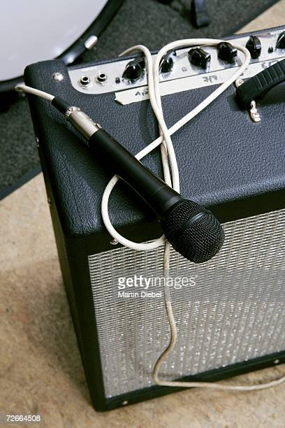 Microphone, amplifier and drum kit