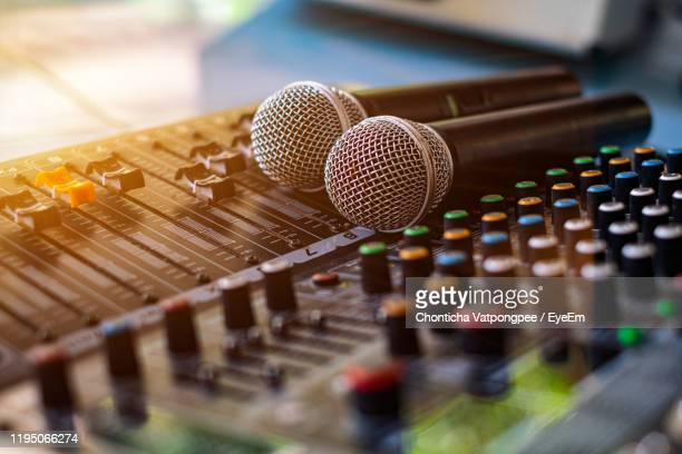 microphone and audio sound mixer analog at the sound control room on blurred background - equaliser stock pictures, royalty-free photos & images