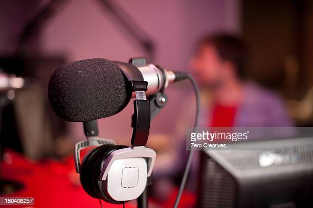 Microphone and headphones in recording studio