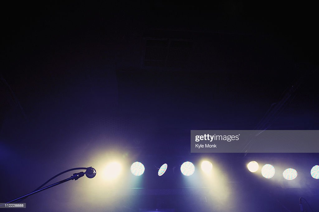 Microphone and spotlights on stage : Stock Photo