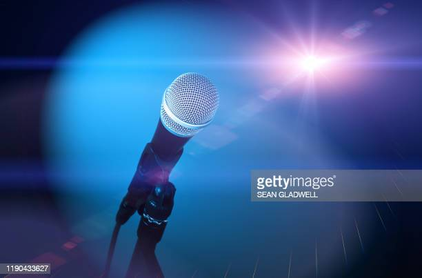 microphone and stage light - popular music concert stock pictures, royalty-free photos & images