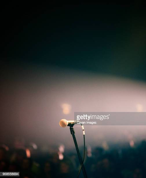 microphone at concert hall - microphone stand stock photos and pictures