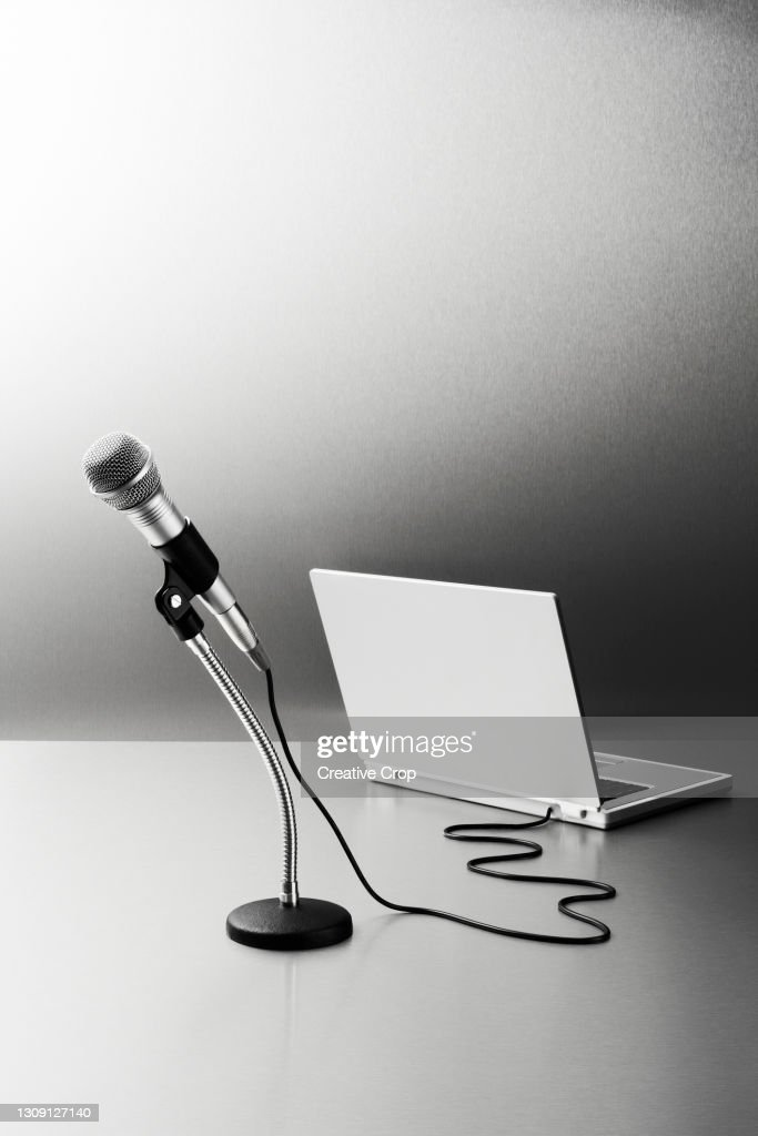 Microphone connected to a laptop computer : Stock Photo