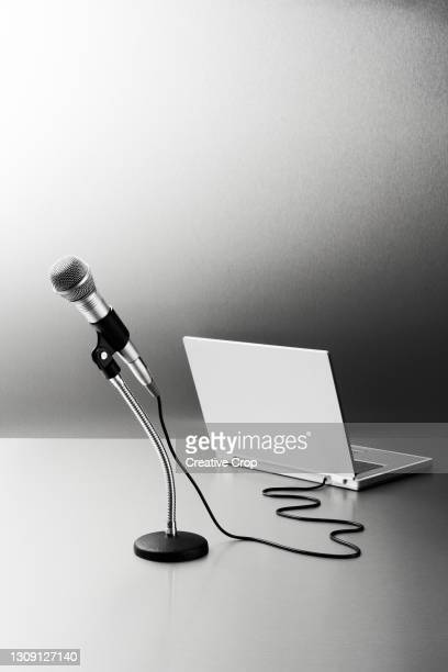 microphone connected to a laptop computer - microzoa stock pictures, royalty-free photos & images