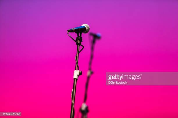 microphone feet with microphones over pink and purple - pop music stock pictures, royalty-free photos & images