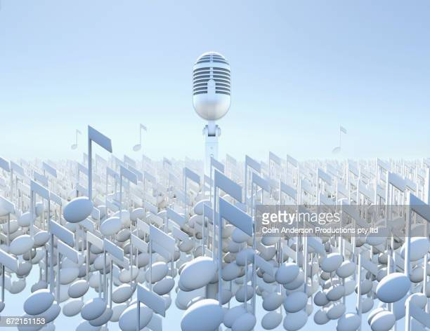 Microphone floating over musical notes