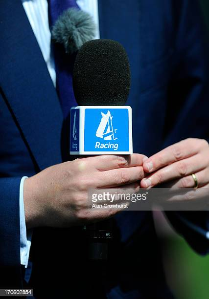 Microphone held by tv presenter Nick Luck of Channel 4 Racing at York racecourse on June 15 2013 in York England