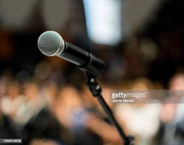 microphone in front of audience - press conference stock pictures, royalty-free photos & images