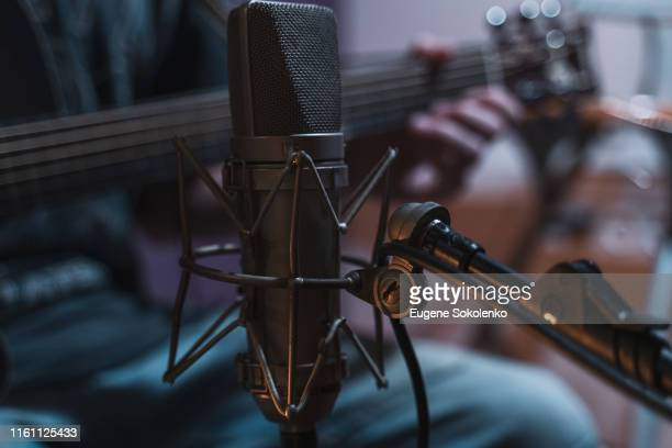 microphone in recording studio - podcast stock-fotos und bilder